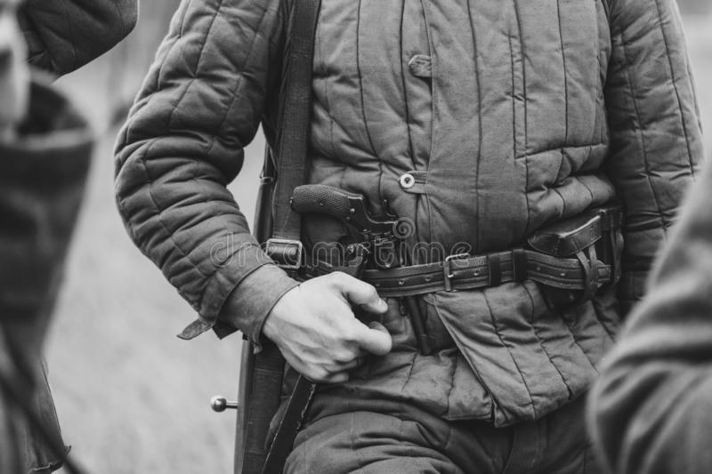 Revolver Nagan on the belt of the Soviet soldier stock photo