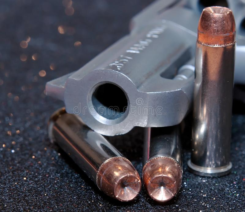 A revolver with three hollow point bullets stock photos
