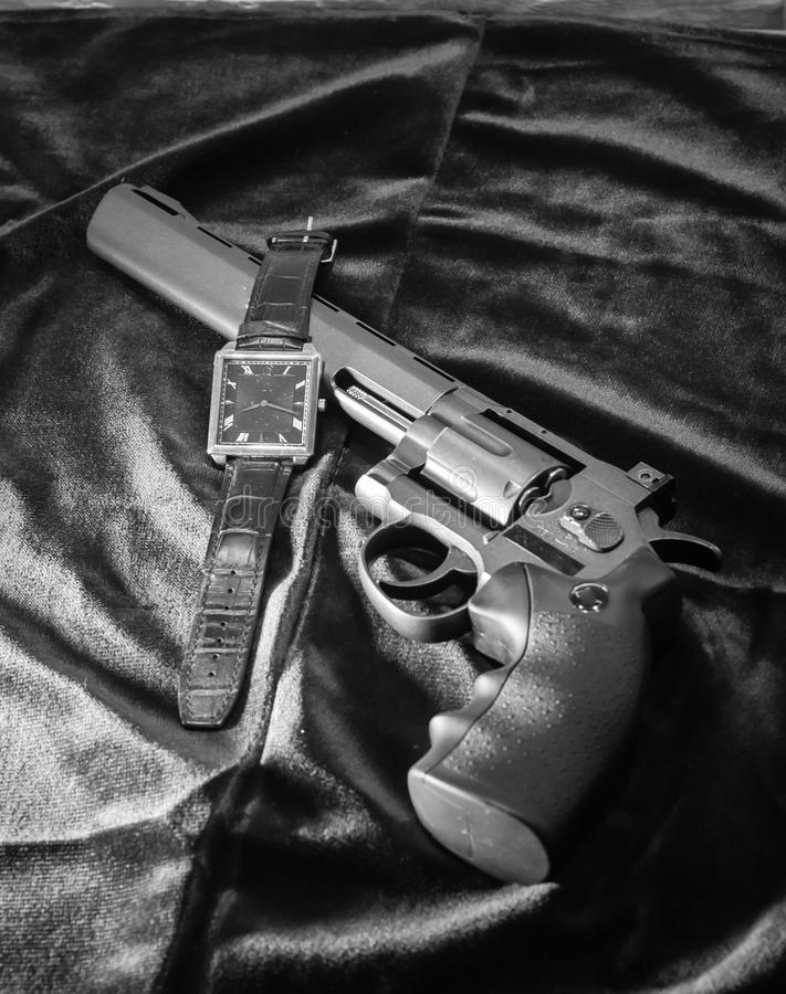 The revolver and the watch royalty free stock photos