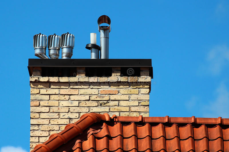 Revolving cowls eradicate downdraught in chimneys. Flues and ducts royalty free stock photography