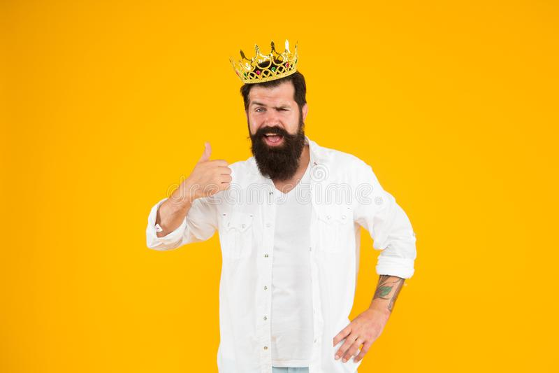 Reward concept. brutal guy prince yellow background. King of party. Egoist selfish man. Superstar concept. Royal status. Sense of self importance. Love royalty free stock photos