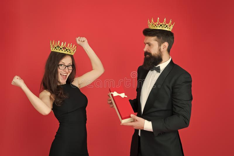 Reward. man in tuxedo and sexy woman. Bearded man and happy woman in crown. royal couple in love. date success. fashion. Reward. men in tuxedo and sexy woman royalty free stock photos