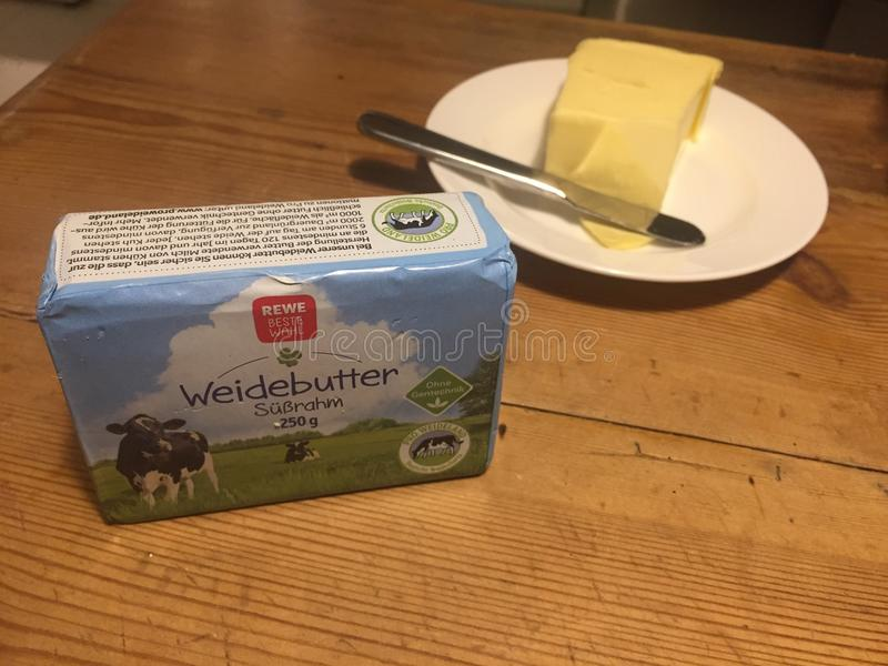 REWE block of pasture butter. Berlin, Germany - January 31, 2018: REWE pasture butter pat. The REWE Group is a German diversified retail and tourism co-operative royalty free stock photos