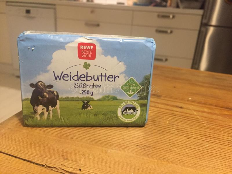 REWE block of pasture butter. Berlin, Germany - January 31, 2018: REWE pasture butter pat. The REWE Group is a German diversified retail and tourism co-operative royalty free stock photography