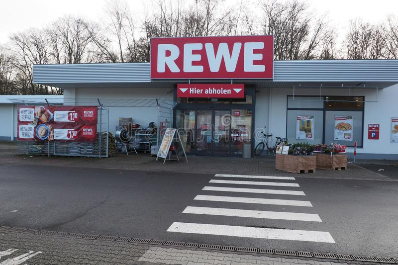 A Rewe supermarket in Frankfurt, Germany. Entrance of a Rewe supermarket in Frankfurt, Germany. REWE is a supermarket chain in Germany and part of the Cologne royalty free stock image