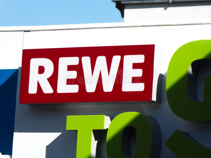 Rewe To Go supermarket signboard. Berlin, Germany - July 23, 2018: Rewe To Go supermarket signage. The REWE Group is a German diversified retail and tourism co royalty free stock images