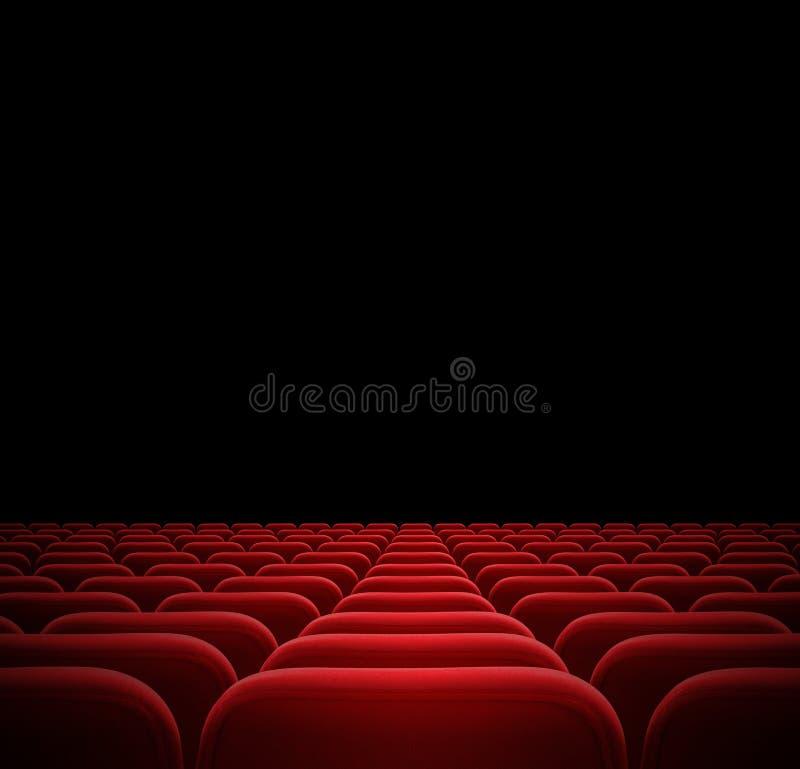 Rewolucjonistek siedzenia w ciemnym kinie zdjęcie royalty free