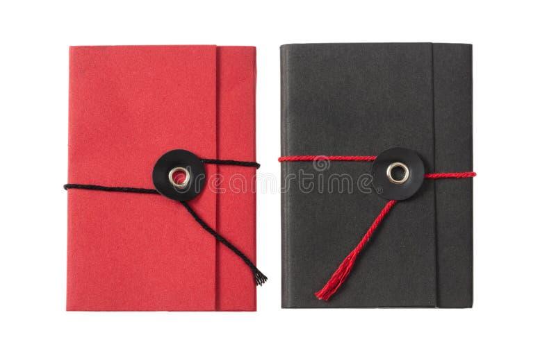 Rewolucjonistki i czerni kieszeniowi notepads odizolowywający na białym tle, odgórny widok obraz stock