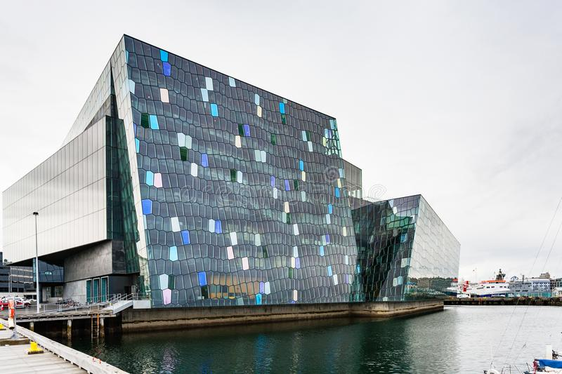 Harpa concert hall in Reykjavik city in autumn. REYKJAVIC, ICELAND - SEPTEMBER 5, 2017: Harpa concert hall in Reykjavik city in autumn. Harpa was designed by the stock photos