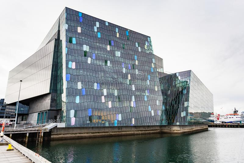 Harpa conference centre in Reykjavik city. REYKJAVIC, ICELAND - SEPTEMBER 5, 2017: Harpa conference centre in Reykjavik in autumn. Harpa was designed by the firm stock images
