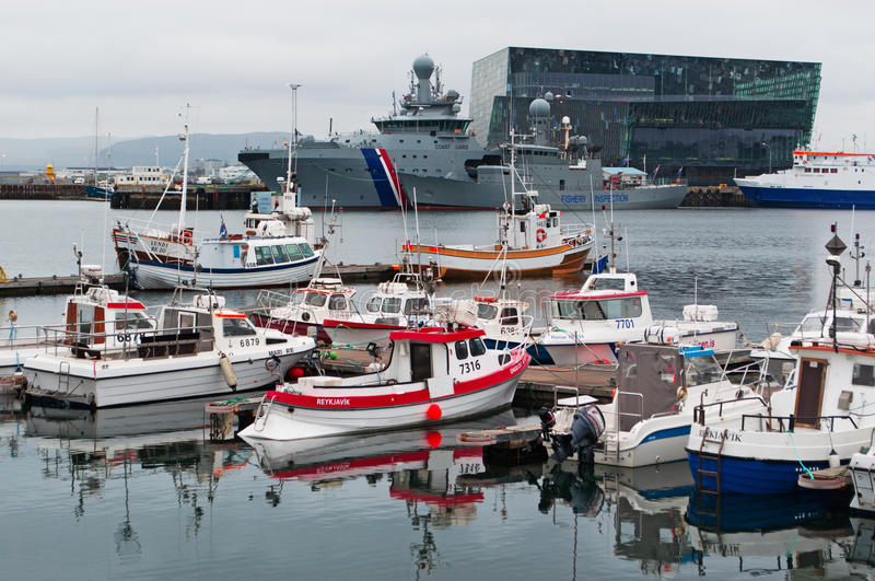 Reykjavik, Iceland, Northern Europe. View of harbour with Harpa on the background on August 30, 2012. Harpa is a concert hall and conference centre designed by stock photography
