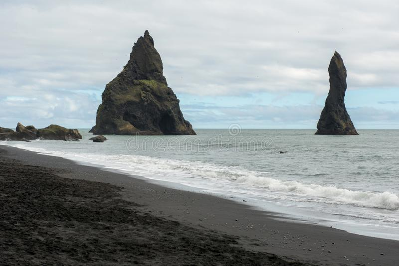 Reynisdrangar basalt sea stacks, Iceland. Reynisdrangar basalt sea stacks in the Atlantic ocean, obe of the filming locatons of the Game of Thrones movie. Vik royalty free stock photos