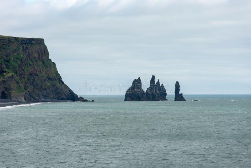 Reynisdrangar basalt sea stacks, Iceland. Reynisdrangar basalt sea stacks in the Atlantic ocean, obe of the filming locatons of the Game of Thrones movie. Vik royalty free stock photo