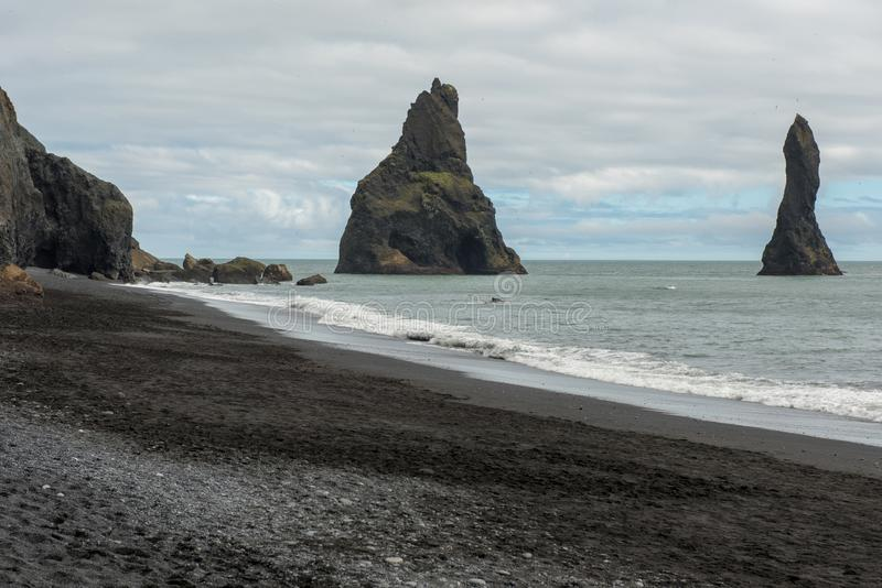 Reynisdrangar basalt sea stacks, Iceland. Reynisdrangar basalt sea stacks in the Atlantic ocean, obe of the filming locatons of the Game of Thrones movie. Vik royalty free stock photography