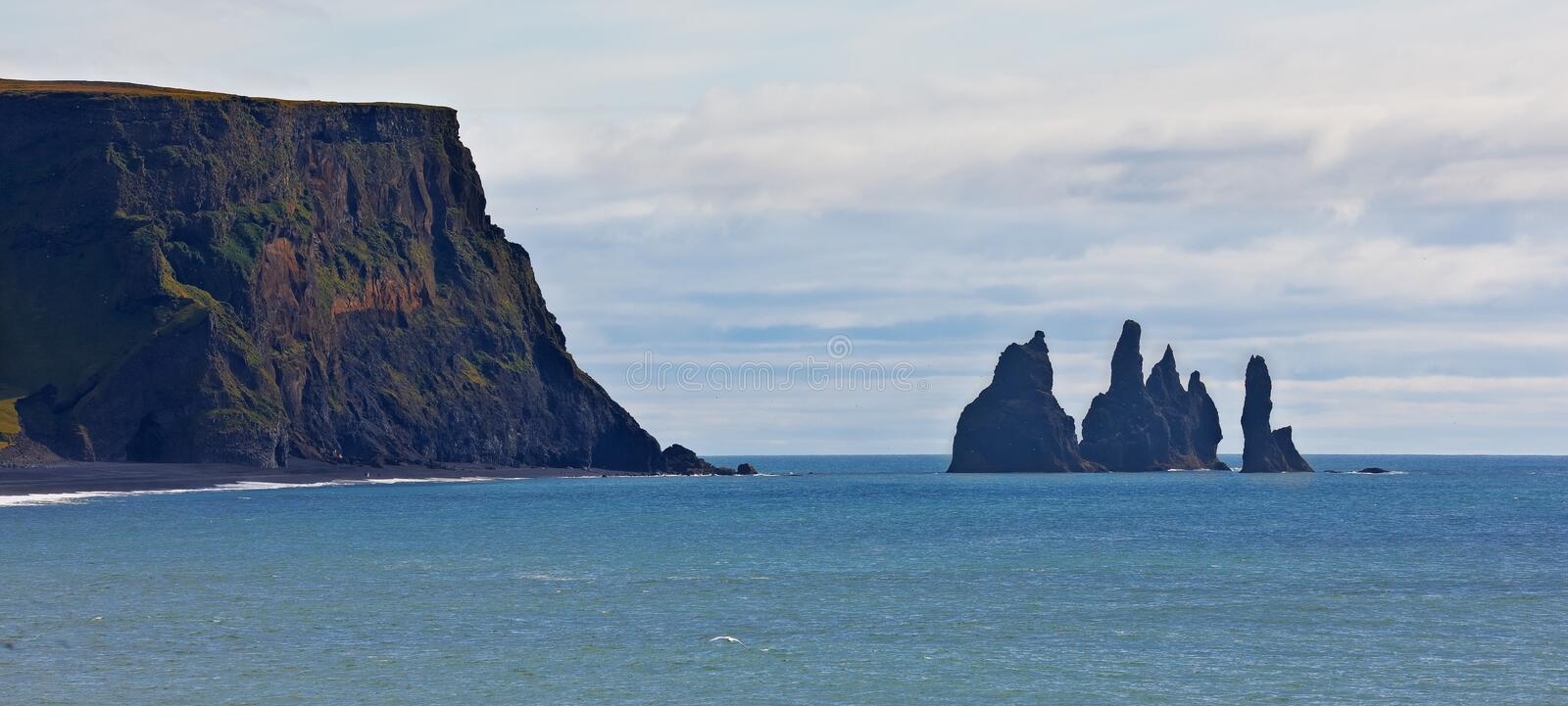 Reynisdrangar, Iceland. Reynisdrangar near the village of Vik east of Dyrholaey, the southernmost point of Iceland stock photo