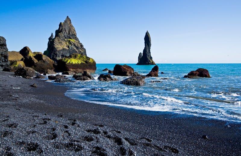 Reynisdrangar, Iceland. Reynisdrangar, black lava beach and sea rocks stock photography