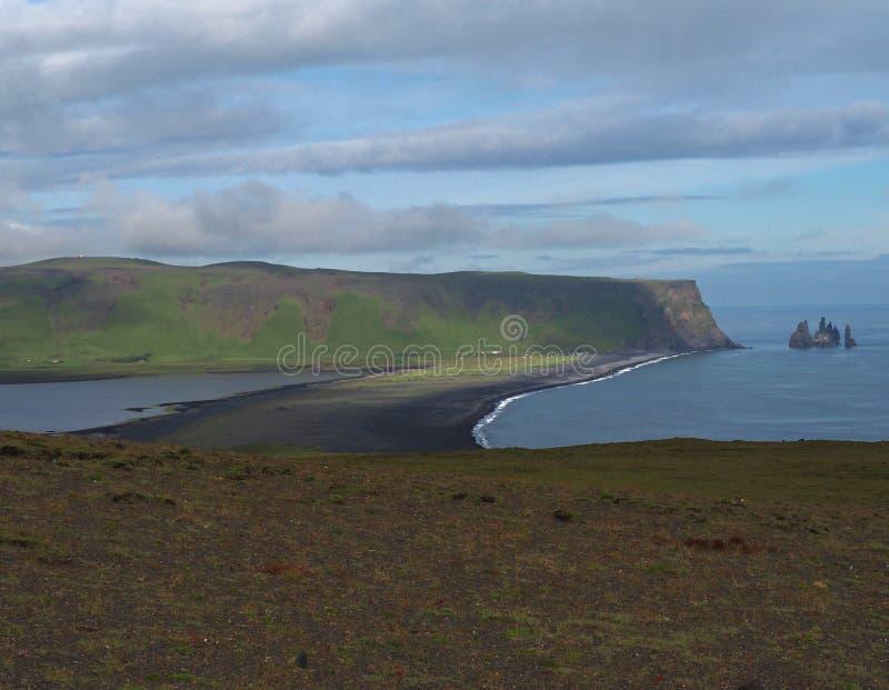 Reynisdrangar - magic iceland landscape with black lava sand and stock photo