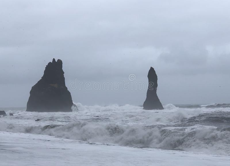 Reynisdrangar. Rock formations. These 60 meter rock formations stand in front of the coast of south Iceland royalty free stock photography