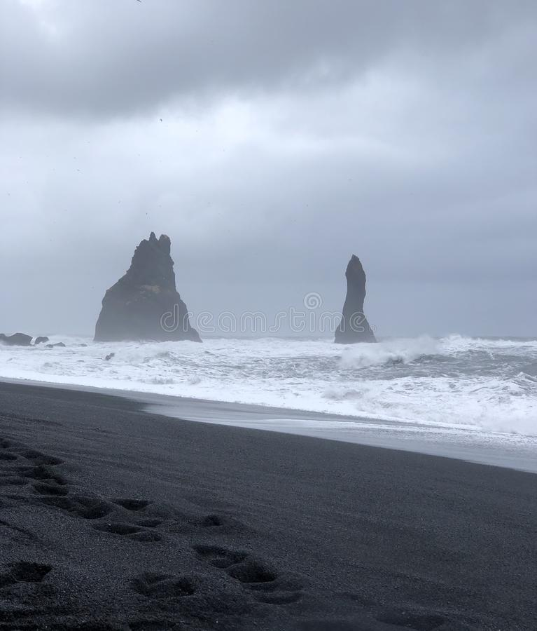 Reynisdrangar. Rock formations. These 60 meter rock formations stand in front of the coast of south Iceland royalty free stock photo