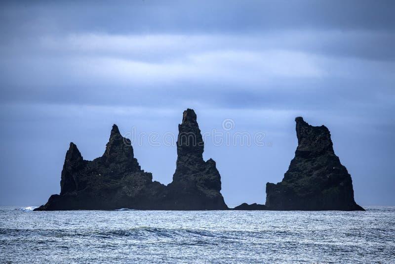 Dyrholay Rocks Iceland. Reynisdrangar sea stacks from Dyrholaey stock photography