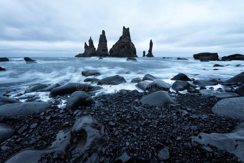 Reynisdrangar seastacks, Iceland. Reynisdrangar seastacks near Reynisfjara beach by the coastal village Vik, Iceland royalty free stock image