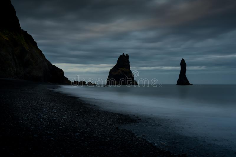 Reynisdrangur sea stacks off Black Sand Beach, Reynisfjara, Iceland stock image