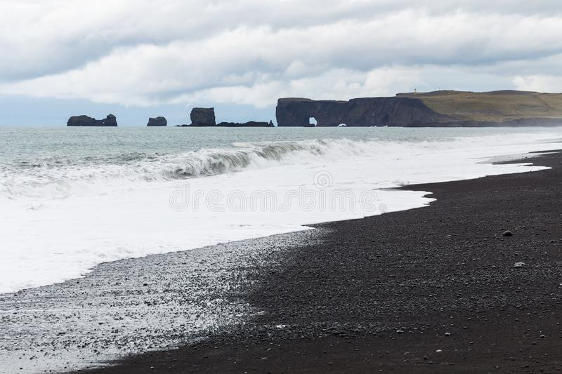 Reynisfjara Beach and Dyrholaey cape in Iceland. Travel to Iceland - Reynisfjara Beach and Dyrholaey cape in Iceland, near Vik I Myrdal village on Atlantic South royalty free stock photo