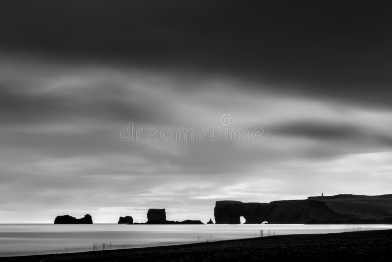 Reynisfjara Beach and Dyrholaey at Vik, Iceland. Fine Art, Black and White landscape of the Reynisfjara Beach and Dyrholaey stock photo