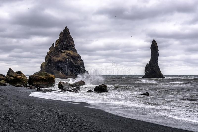 Reynisfjara Beach in Iceland, near Vik with a threatening sky stock image