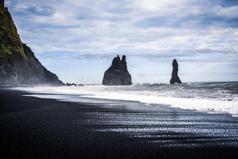 Reynisfjara beach with a view of the protruding rocks of the large waves stock photo