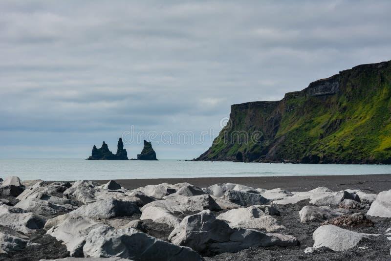 Reynisfjara black sand beach and rocks near Vik town, Iceland royalty free stock image