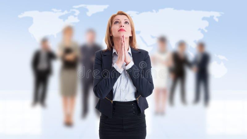 Rezar da mulher de negócio imagens de stock