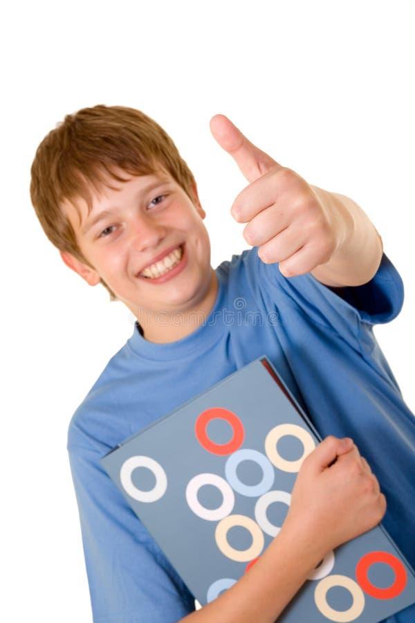 rezerwuje kolorowego uśmiechniętego ucznia zdjęcie stock