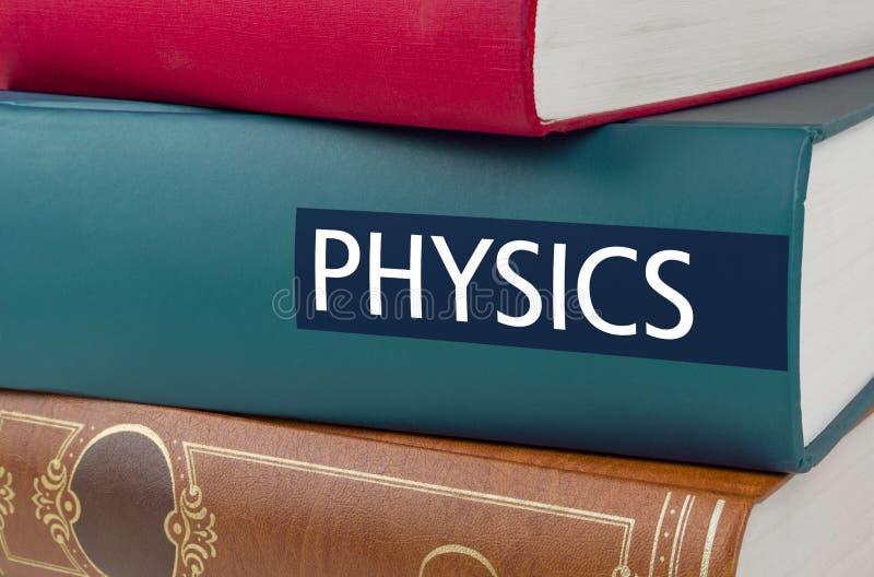 Rezerwuje z tytułowym Physics pisać na kręgosłupie zdjęcie stock