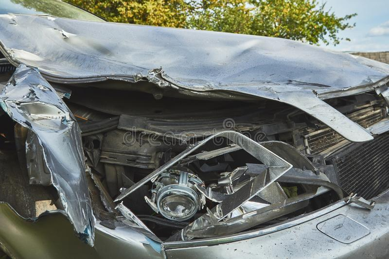 Front side of car after accident on a city road. Rezkene,Latvia, August 26, 2019: car after accident on a road because of frontal collision, transportation royalty free stock image