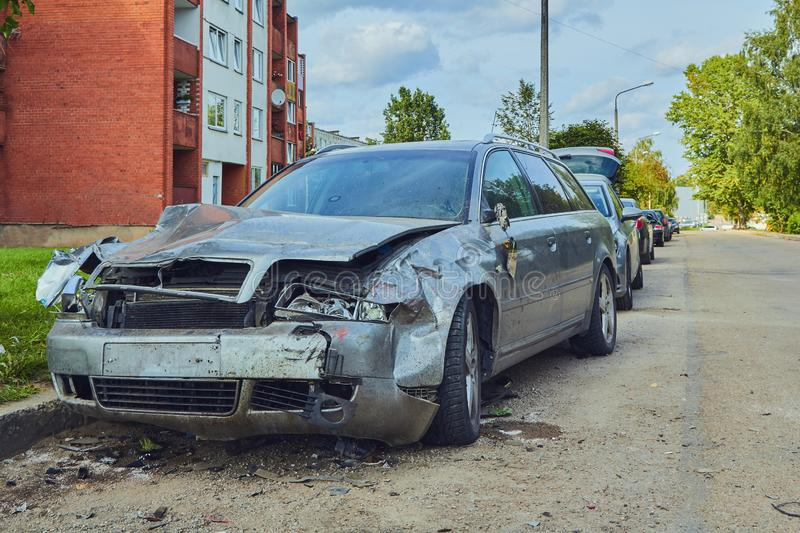 Front side of car after accident on a city road. Rezkene,Latvia, August 26, 2019: car after accident on a road because of frontal collision, transportation stock photo