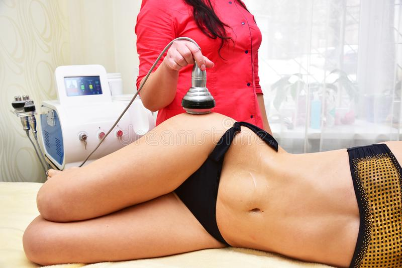 Rf skin tightening, belly. Hardware cosmetology. Body care. Non surgical body sculpting. Ultrasound cavitation body contouring tre stock photography