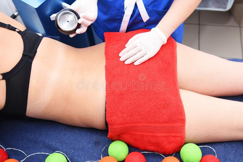 Rf skin tightening. Vacuum massage. Hardware cosmetology. Body care. Non surgical body sculpting. anti-cellulite and anti-fat ther stock photography