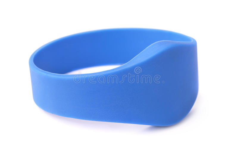 RFID bracelet. Blue silicone RFID bracelet isolated on white stock photos