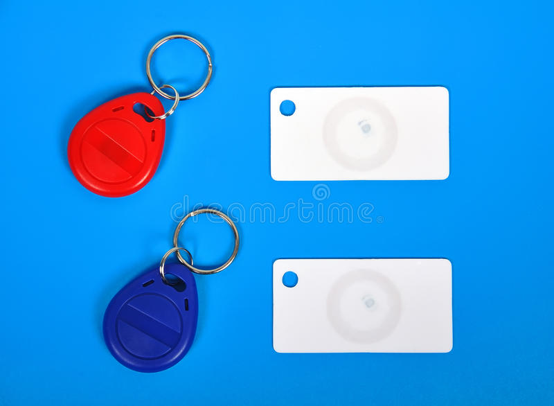 RFID cards and keychain. Two RFID cards and keychain on a blue background stock image
