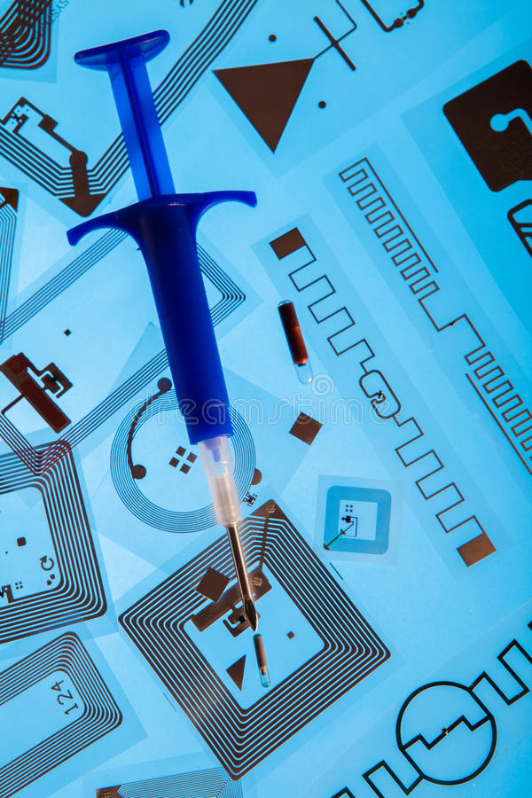 Download RFID Implantation Syringe And RFID Tags Editorial Photography - Image: 42225402