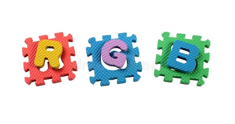 RGB listy ciący z zabawkarskiej plastikowej łamigłówki, odosobnionej na bielu zdjęcia royalty free