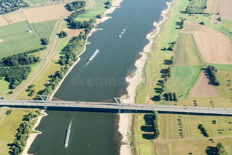 River Rhine in Duesseldorf. Bridge over the river Rhine - Rhein - in the north of Duesseldorf seen from above stock photo