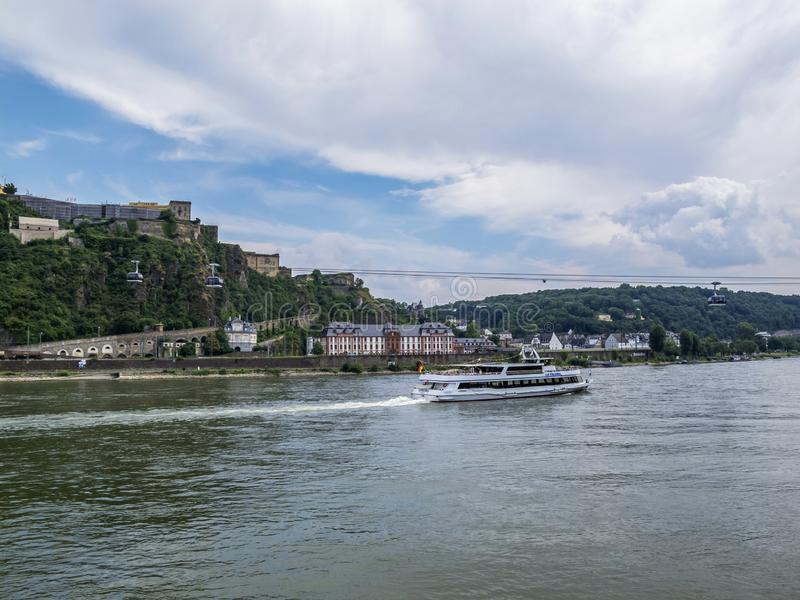 The Rhine River with a cruise ship at Koblenz, Germany. KOBLENZ, GERMANY - AUGUST 09, 2013: View to the Rhine River with a cruise ship, Phillipsburg Palace stock photos