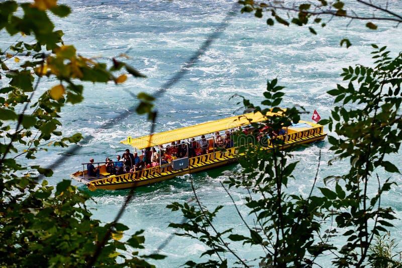 Rhine, Switzerland - September 19, 2018: Tourist ship on the Rhine river near the Rhine falls in Switzerland royalty free stock photos
