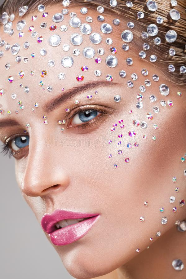 Rhinestone. Makeup. Close-up of young woman with fashion makeup with rhinestone royalty free stock photos