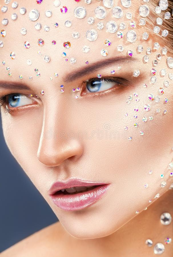 Rhinestone. Makeup. Close-up of young woman with fashion makeup with rhinestone stock photo