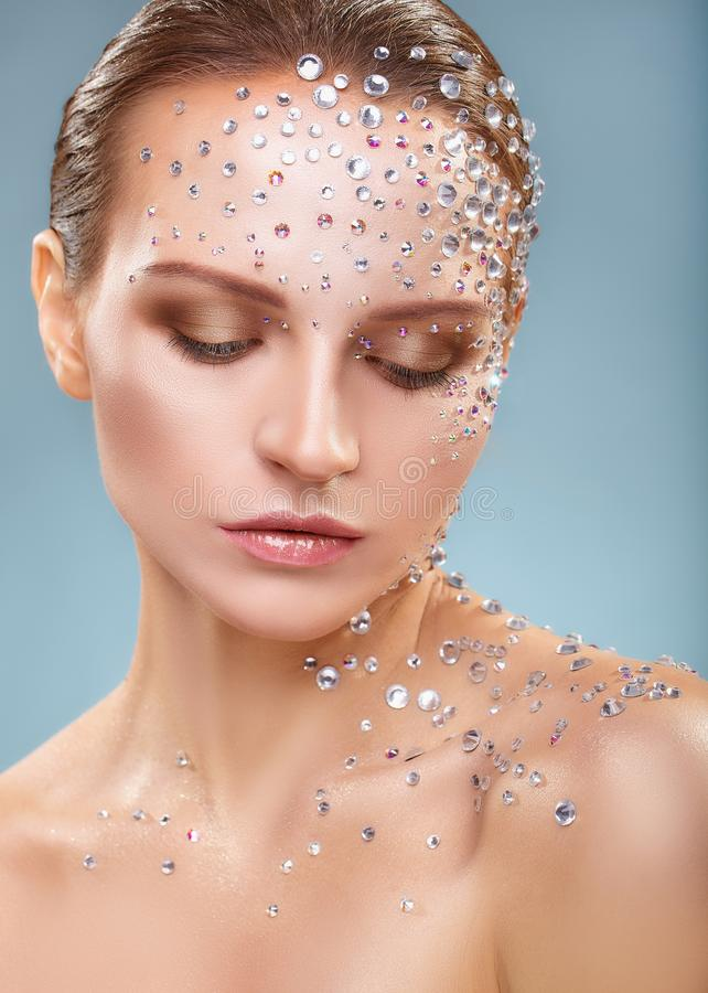 Rhinestone. Makeup. Close-up of young woman with fashion makeup with rhinestone stock images
