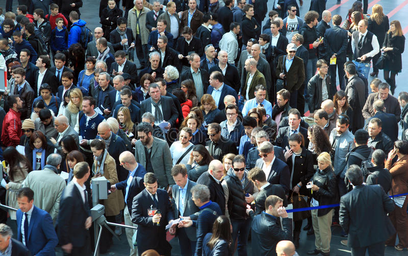 Rho Fiera, people crowd. People crowd enter Rho Fiera to visit Salone Internazionale del Mobile, international home furnishing accessories and interiors design stock images