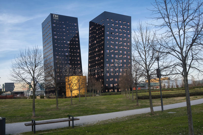 Rho Milan, Italy: two modern towers. RHO, ITALY - MARCH 11, 2017: Rho Milan, Lombardy, Italy, two modern towers hosting a hotel royalty free stock images